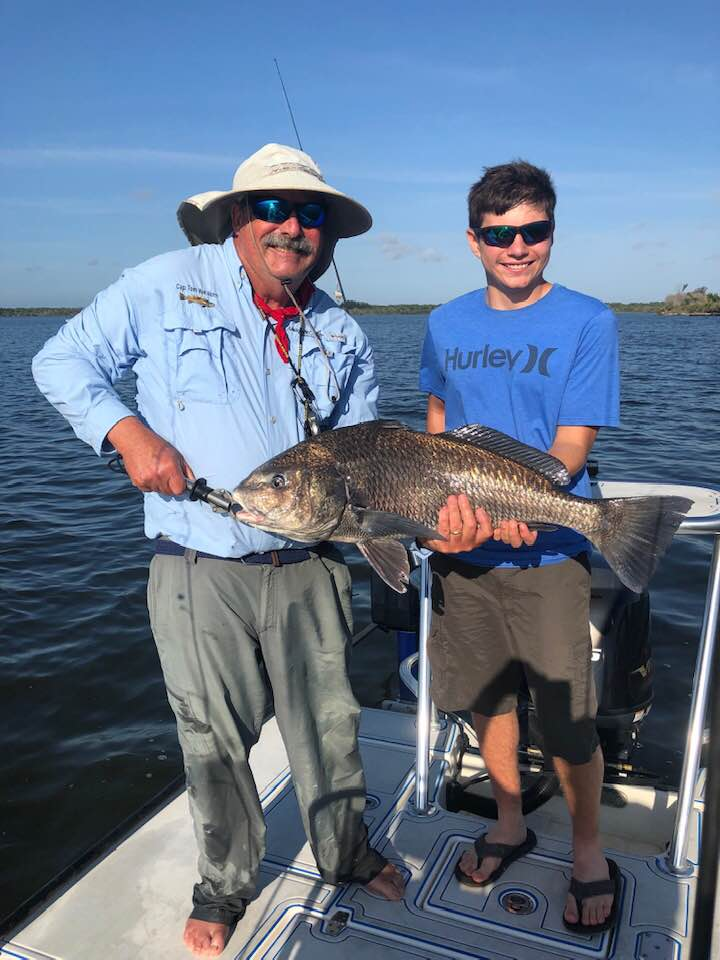 Evan and Captain Tom with one of four Even caught.